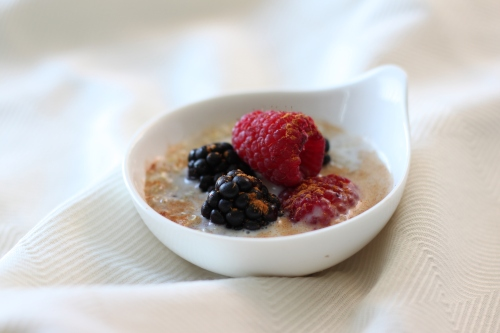 Leftover quinoa warmed with almond milk, cinnamon, maple syrup and fresh berries.